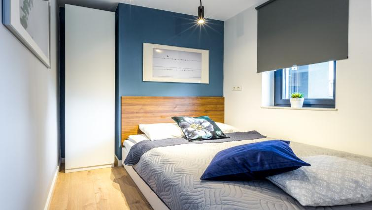Bed at Vistula and Wawel Apartments - Citybase Apartments