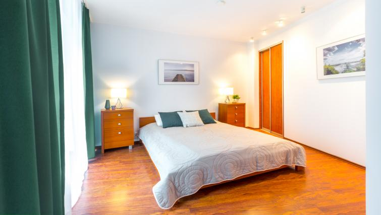 Bright bedroom at  Kazimierza Wielkiego Apartments - Citybase Apartments