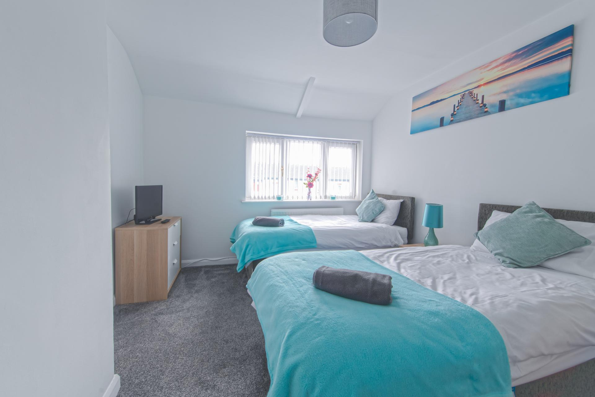 Bedroom at Throstle House Serviced Apartment, Middleton, Leeds - Citybase Apartments