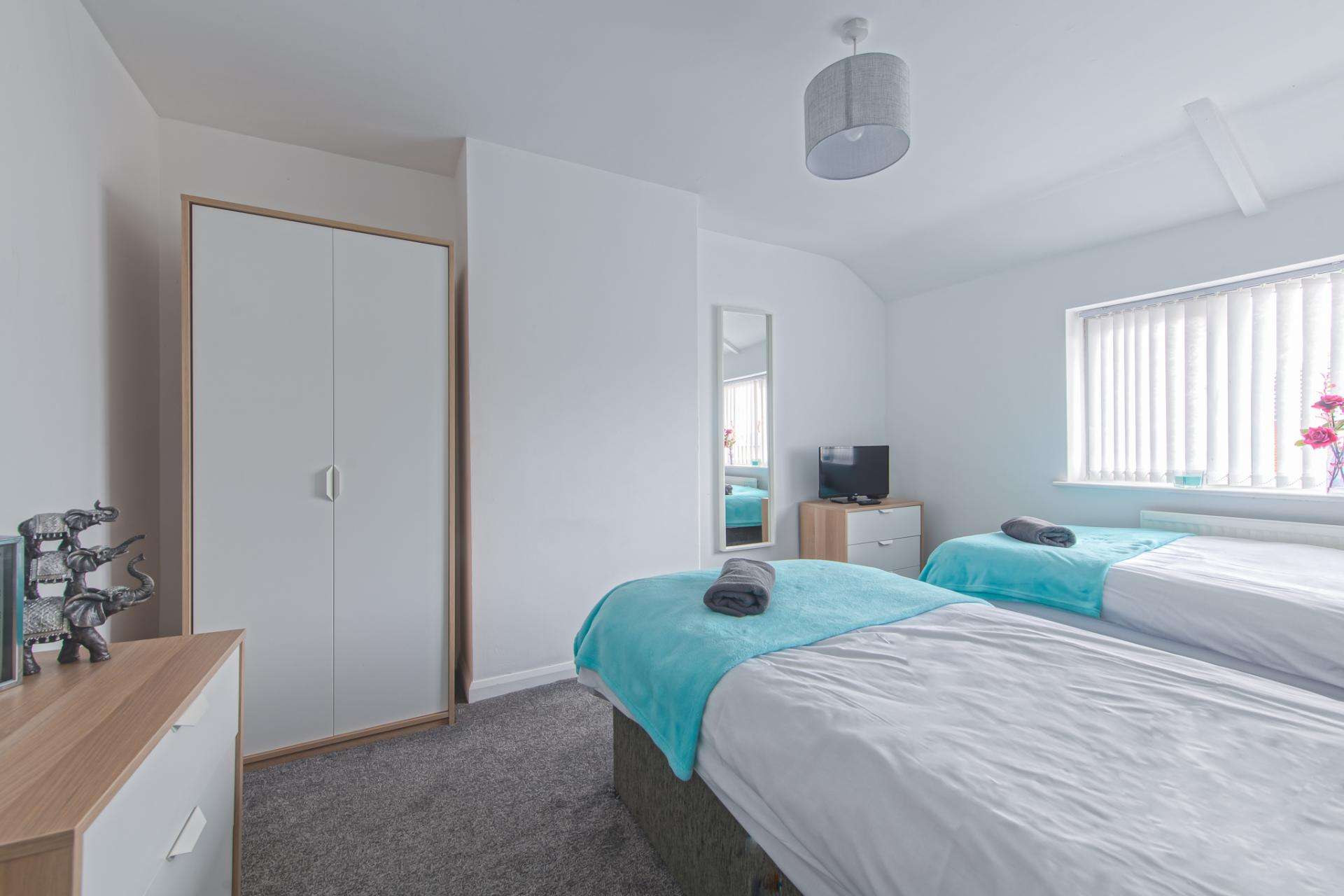 Wardrobe at Throstle House Serviced Apartment, Middleton, Leeds - Citybase Apartments