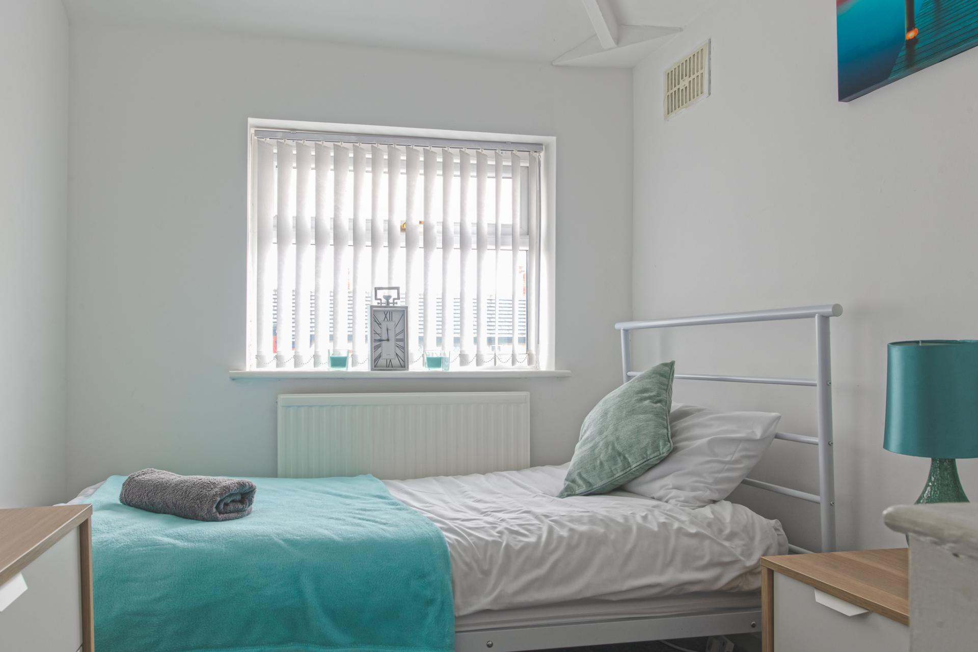 Bright bedroom at Throstle House Serviced Apartment, Middleton, Leeds - Citybase Apartments