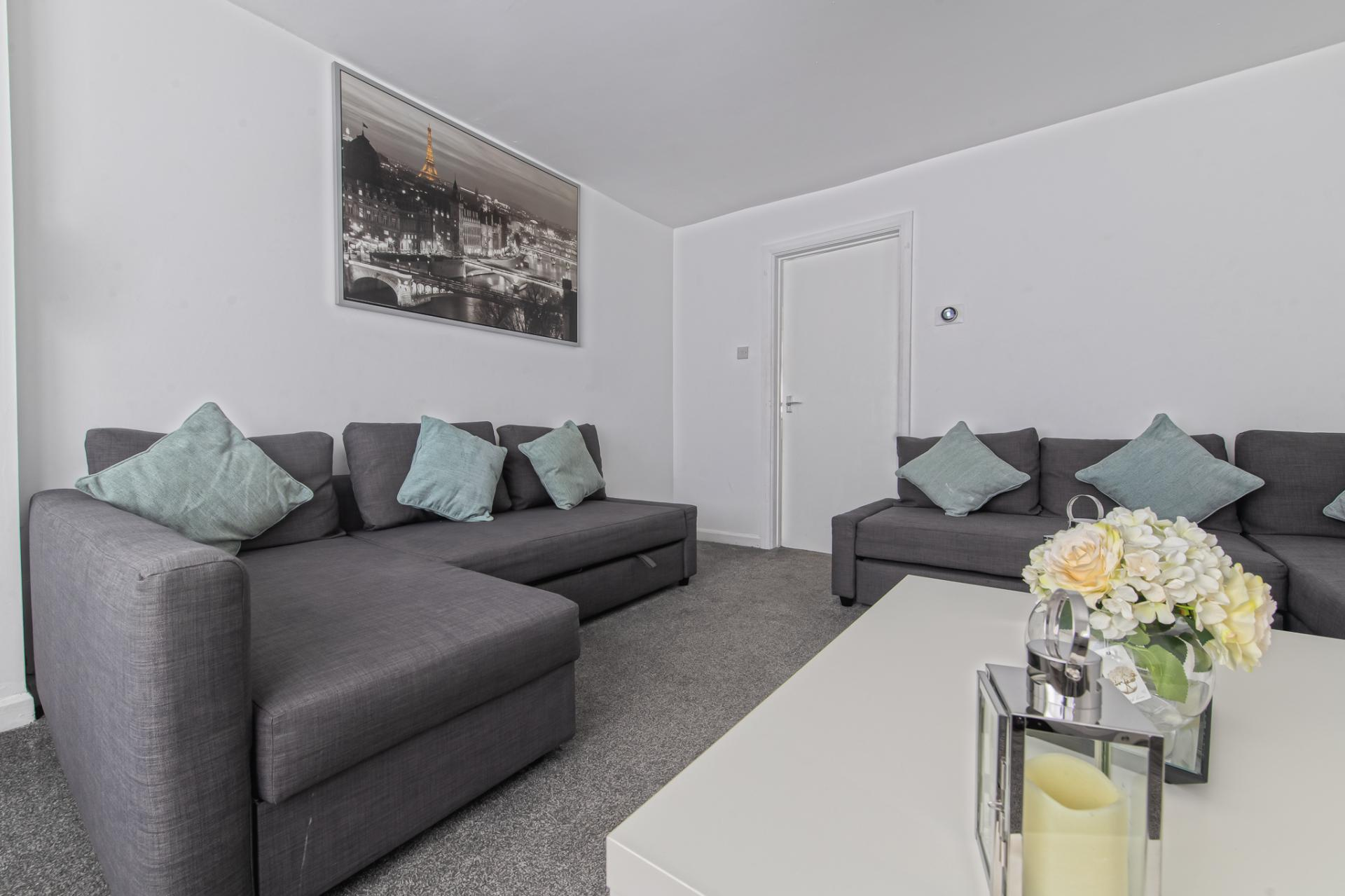 Living Room at Throstle House Serviced Apartment, Middleton, Leeds - Citybase Apartments