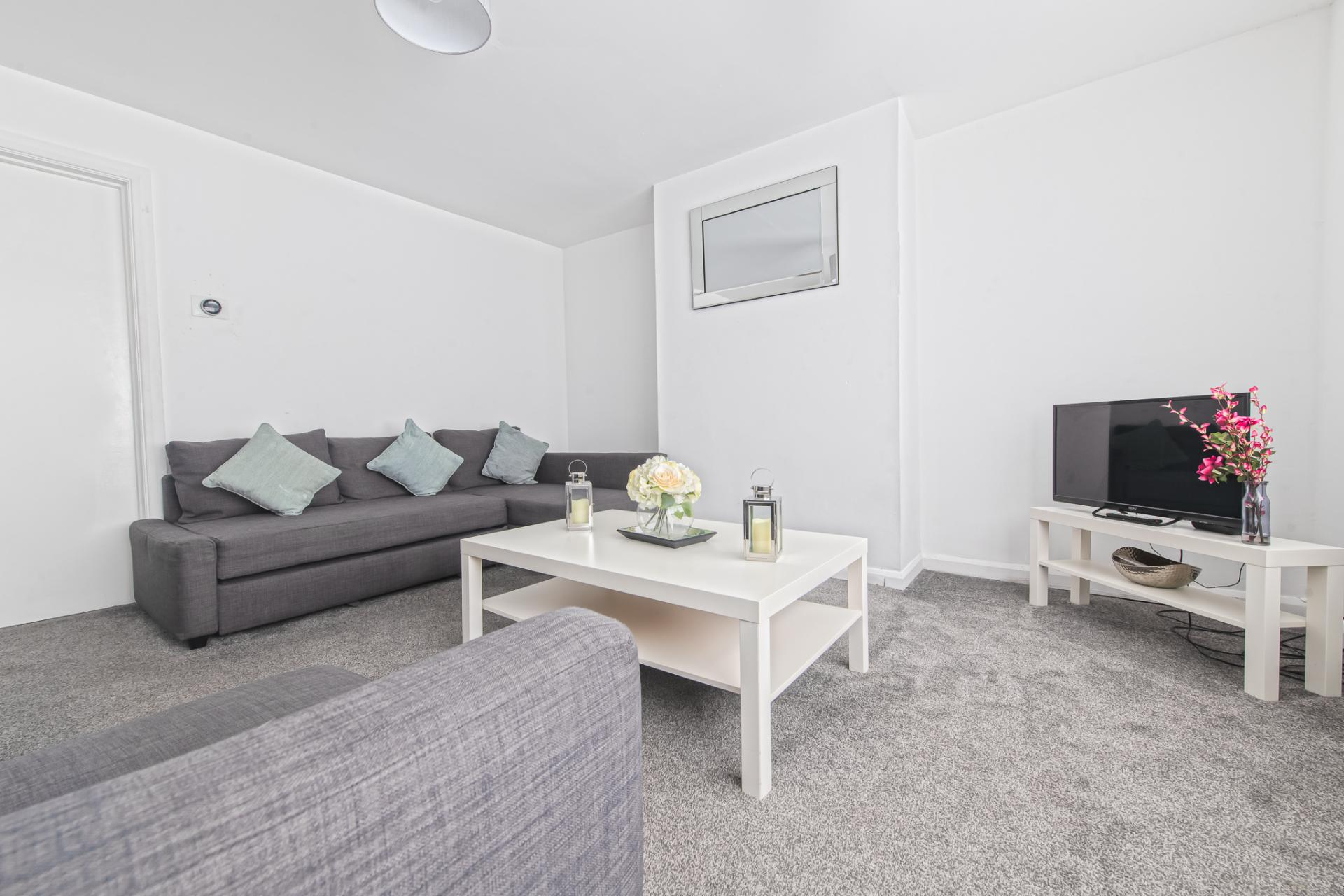 Living area at Throstle House Serviced Apartment, Middleton, Leeds - Citybase Apartments