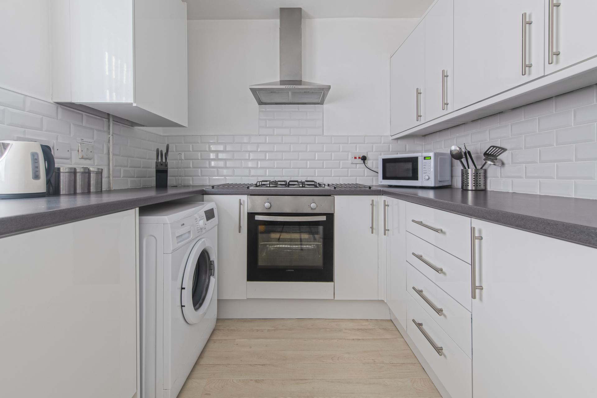 Kitchen at Throstle House Serviced Apartment, Middleton, Leeds - Citybase Apartments