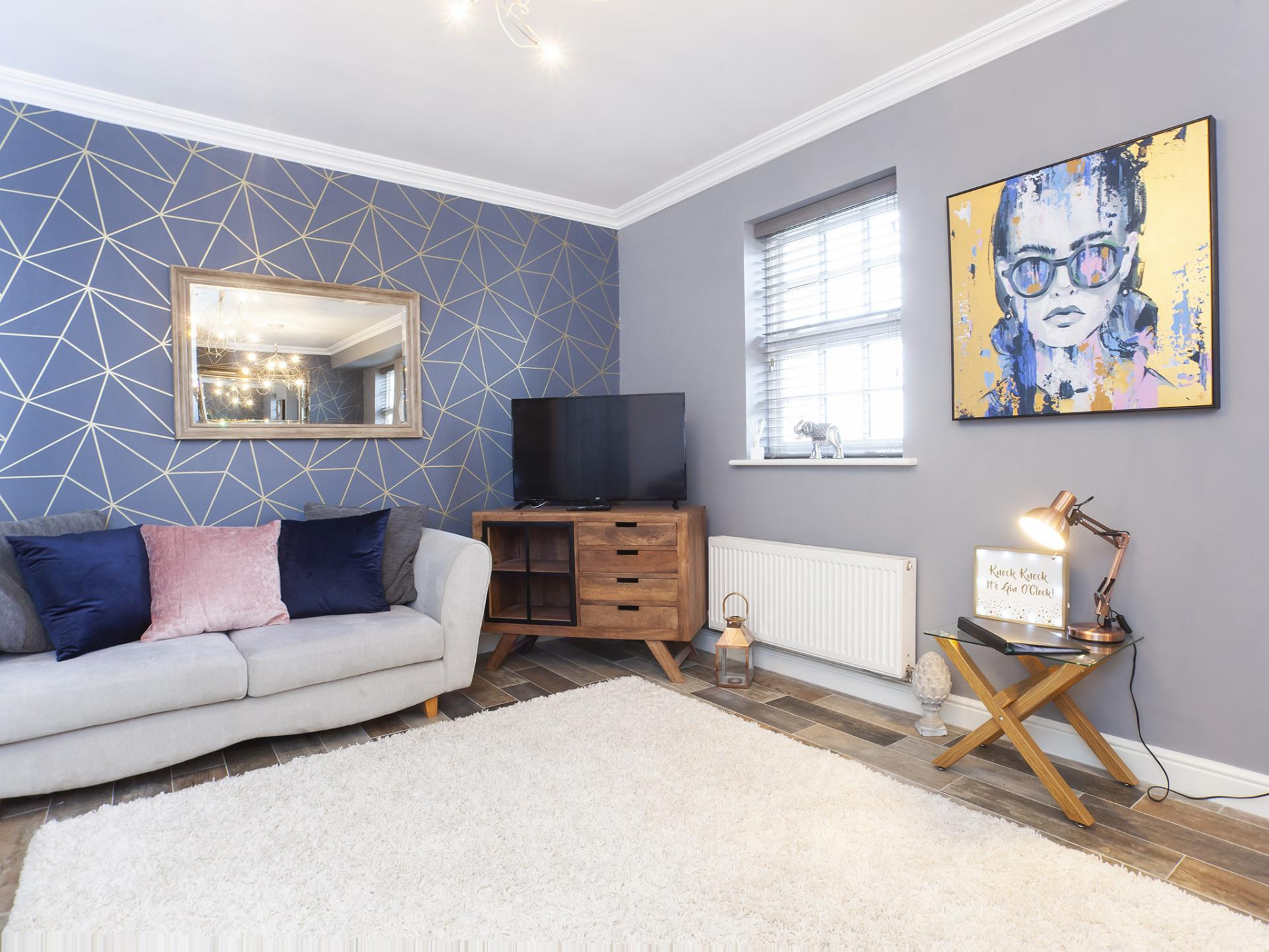 Blue and cream lounge at The Station apartment, Centre, York - Citybase Apartments