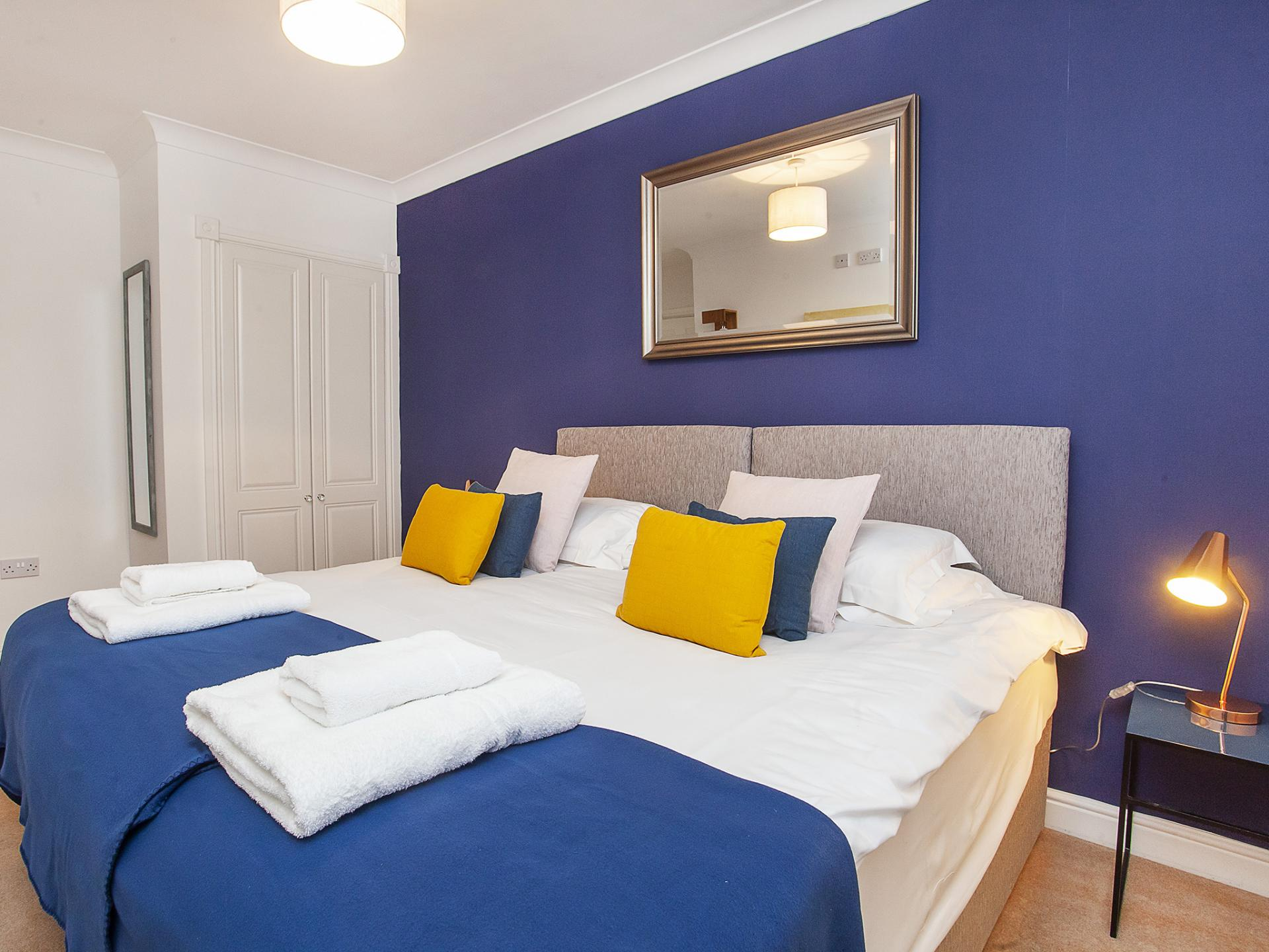 Blue feature wall bedroom at The Station apartment, Centre, York - Citybase Apartments