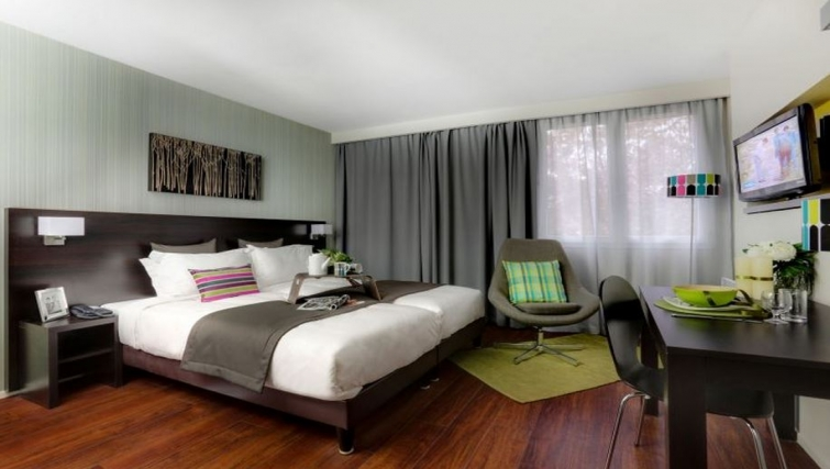Stylish bedroom in Citadines Part-Dieu Apartments - Citybase Apartments