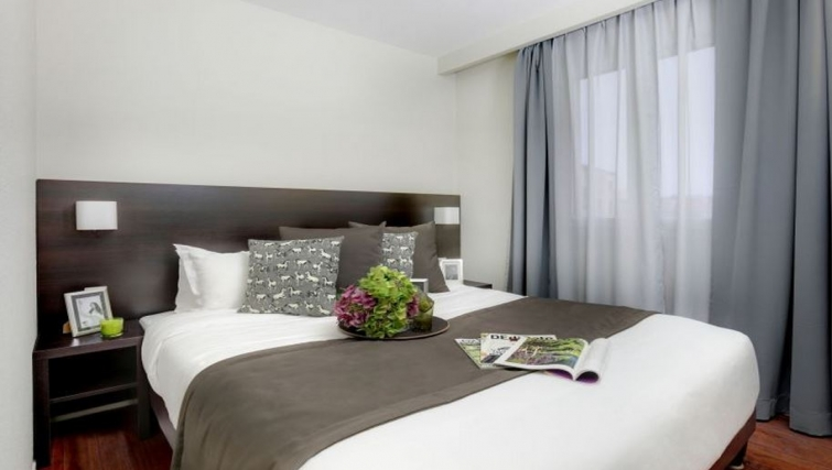 Bedroom in Citadines Part-Dieu Apartments - Citybase Apartments