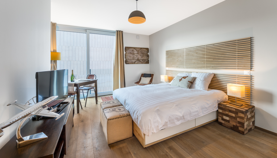 Bright bedroom at the Noirettes Studios - Citybase Apartments
