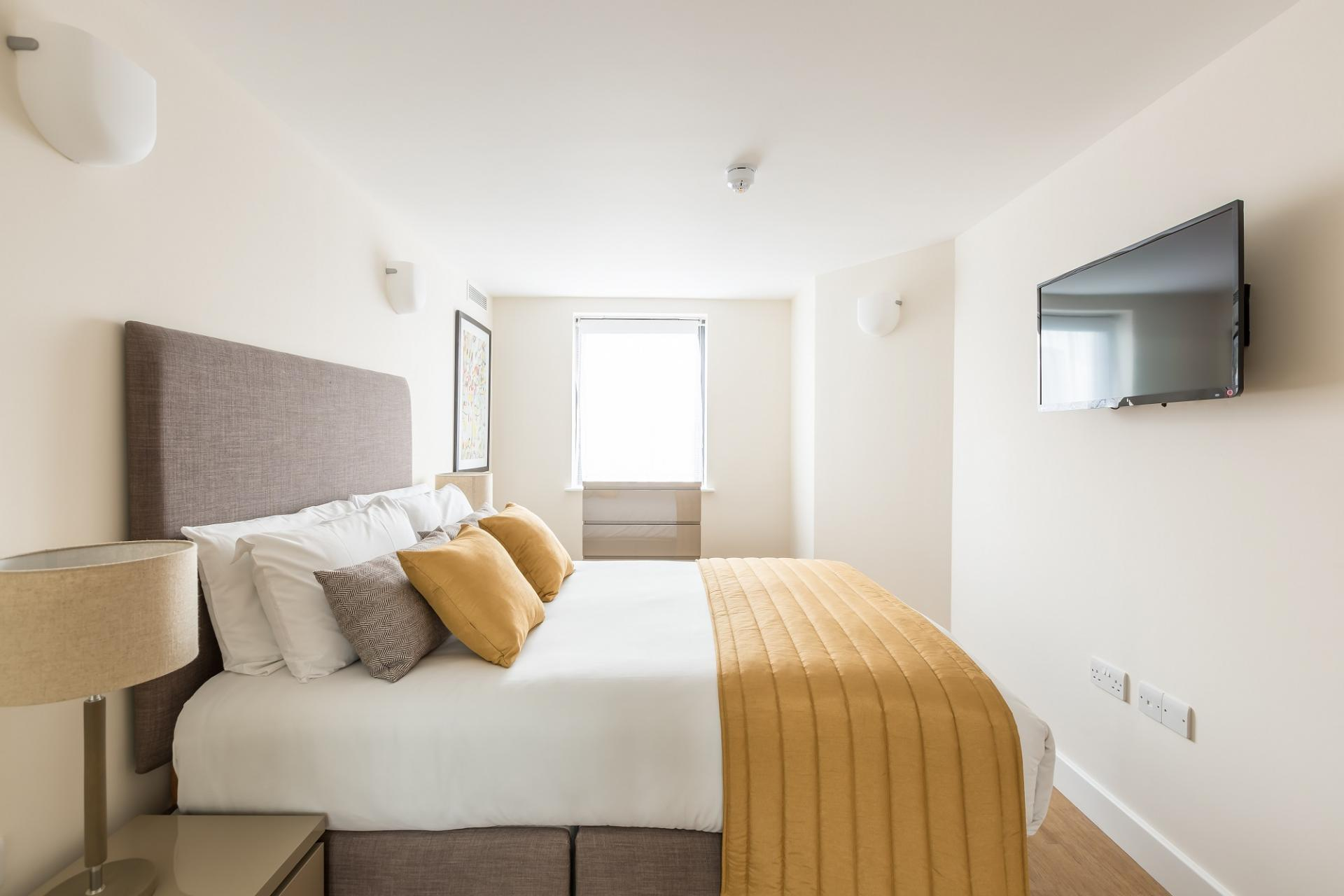 Modern bedroom at City Wall House - Citybase Apartments