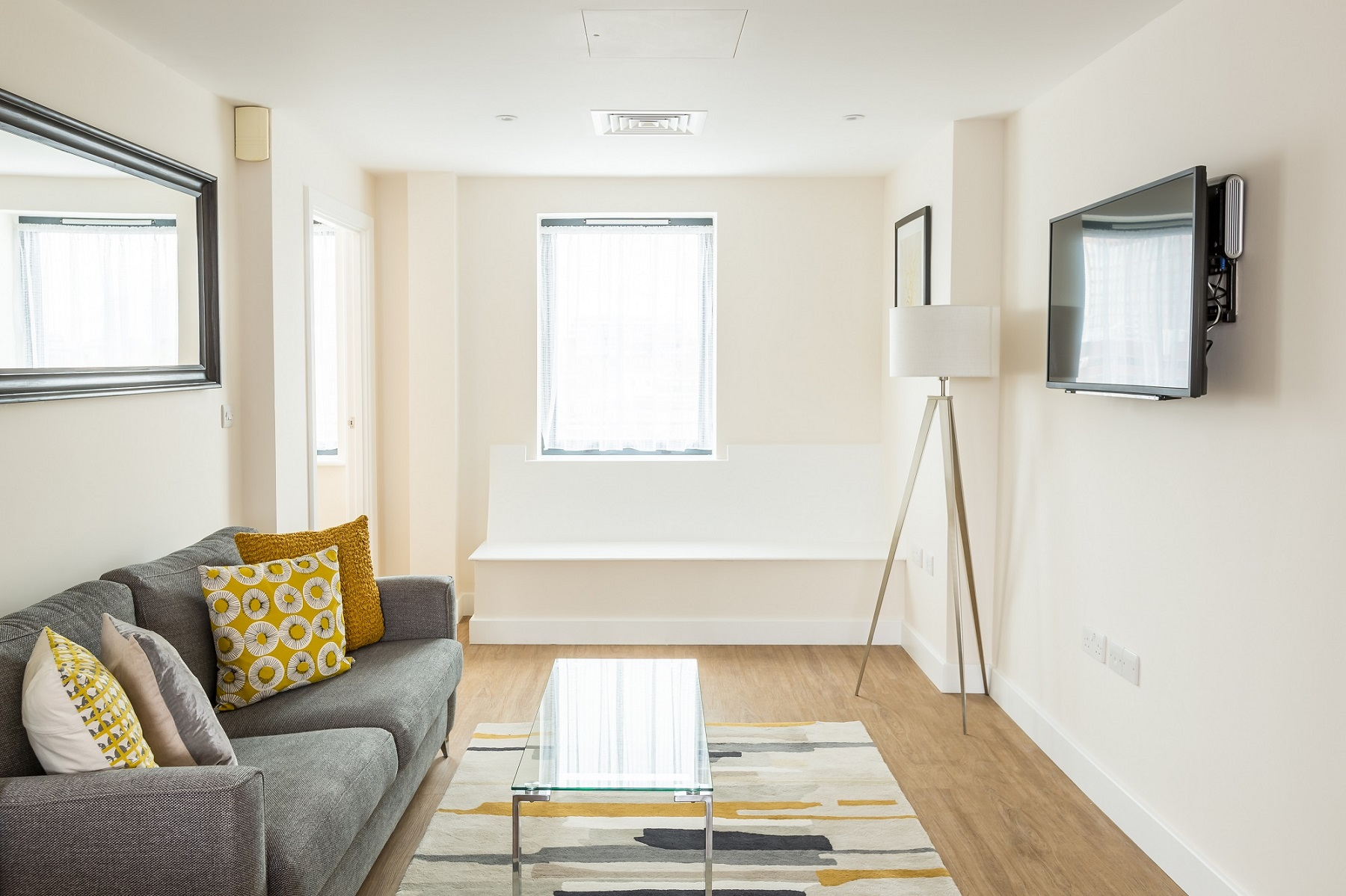 Bright lounge at City Wall House - Citybase Apartments