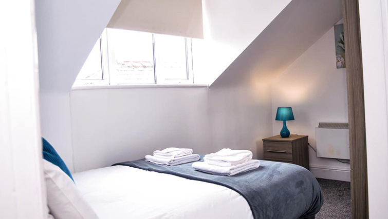 Bright bedroom at  Orrell House Apartments - Citybase Apartments