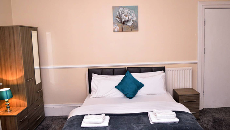 Charming bedroom at  Orrell House Apartments - Citybase Apartments