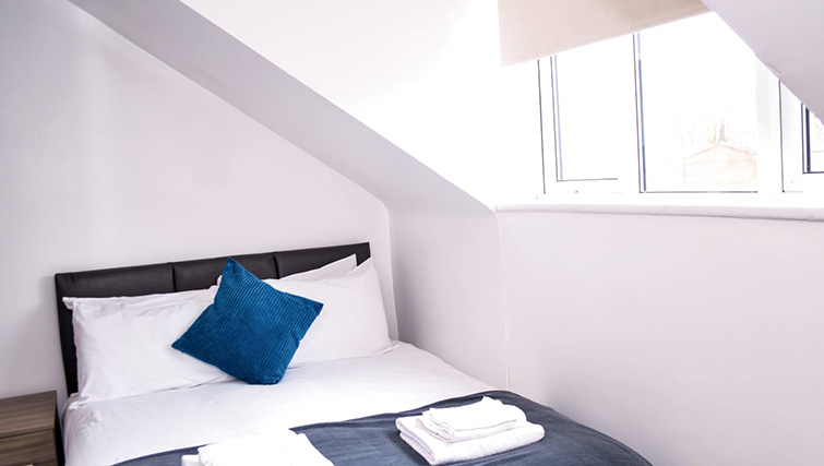 Cosy bedroom at  Orrell House Apartments - Citybase Apartments