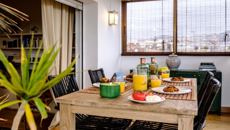 Dining area at Atic Eloi Apartment - Citybase Apartments