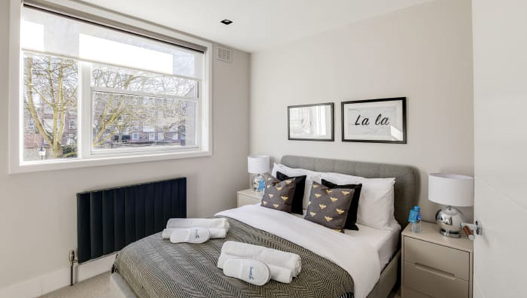 Modern bed at Village in The City Apartment - Citybase Apartments
