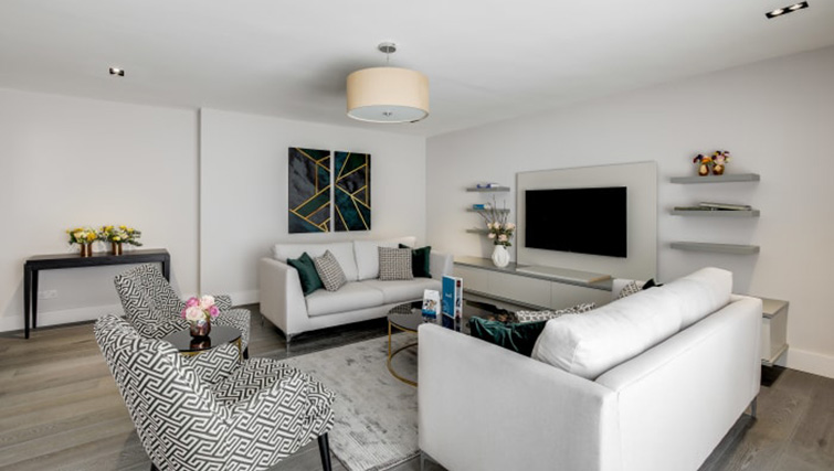 Spacious living area at Village in The City Apartment - Citybase Apartments