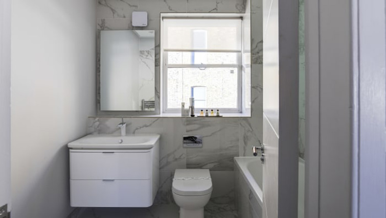 Modern bathroom at Village in The City Apartment - Citybase Apartments