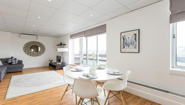 Dining table at Baker Street Apartment - Citybase Apartments
