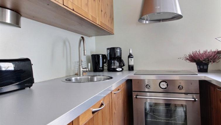 Kitchen at Laromiguiere Apartment - Citybase Apartments