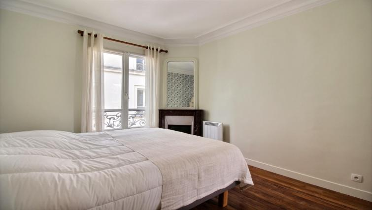 Bedroom at Laromiguiere Apartment - Citybase Apartments
