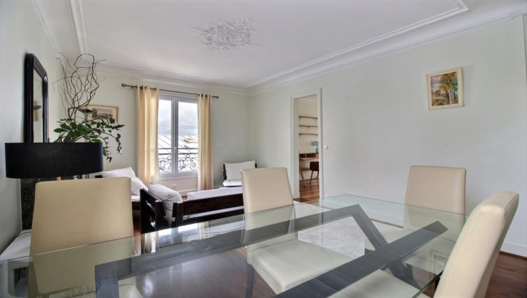 Dining table at Laromiguiere Apartment - Citybase Apartments