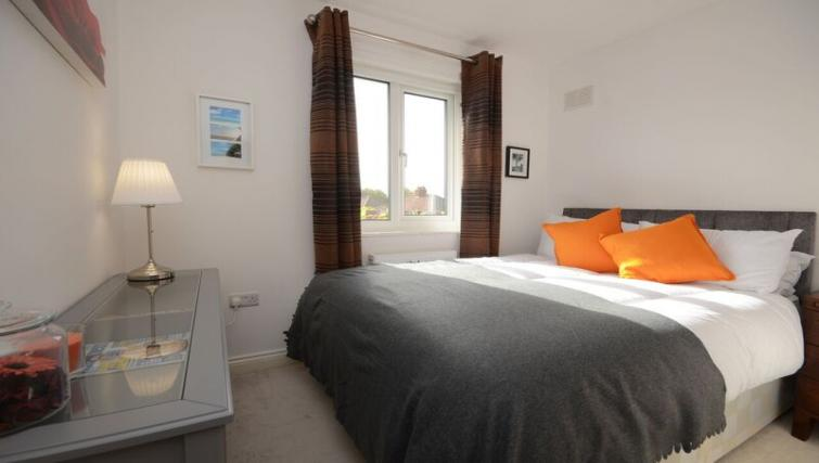 Bright bedroom at Woodlea House - Citybase Apartments