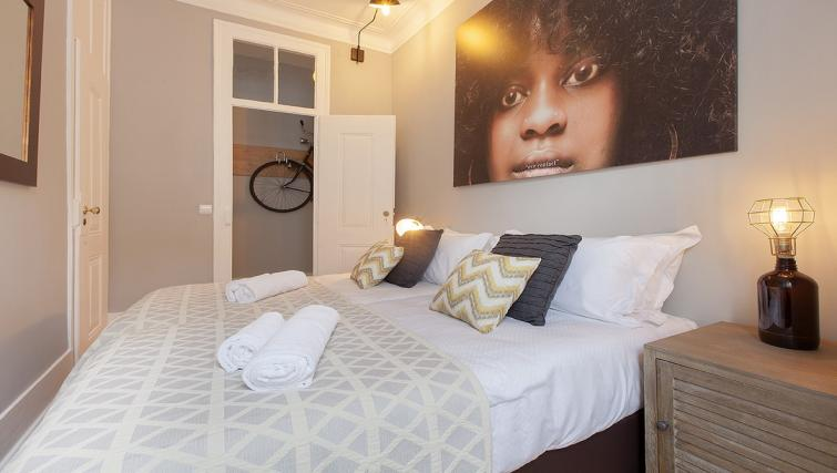 Bed at the Bairro do Amor Apartment - Citybase Apartments