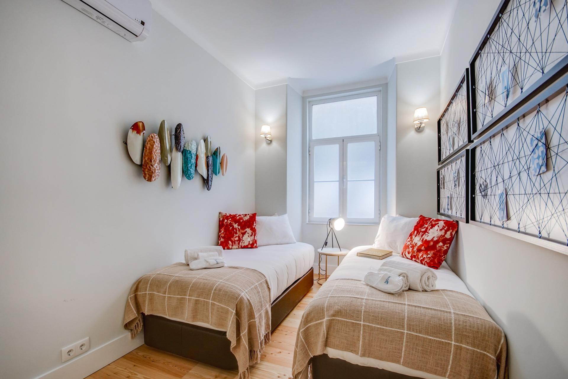 Twin beds at Prata Apartments - Citybase Apartments
