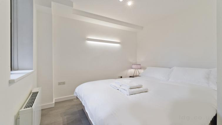 Bright bedroom at Old Compton House Apartments - Citybase Apartments