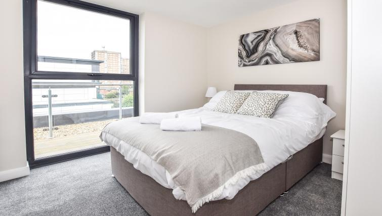 Bed at the Victoria House Apartments - Citybase Apartments
