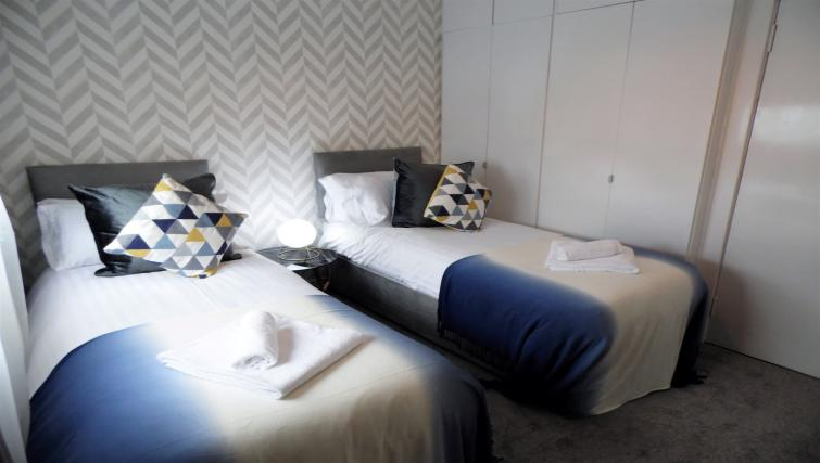 Twin beds at Ness View Apartment - Citybase Apartments