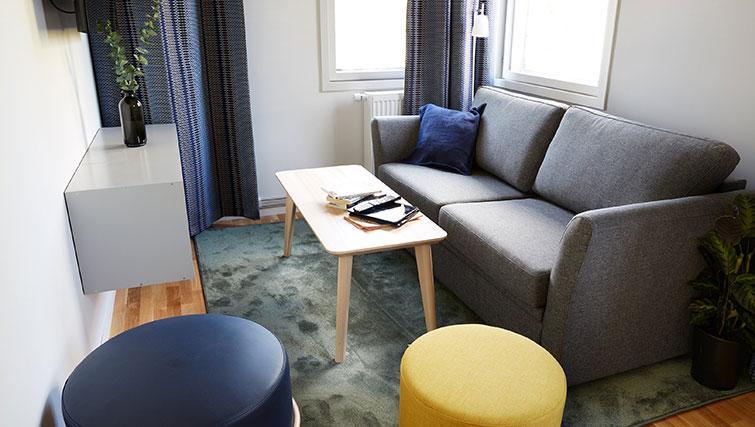 Sofa at at Forenom Aparthotel Stockholm Kista - Citybase Apartments