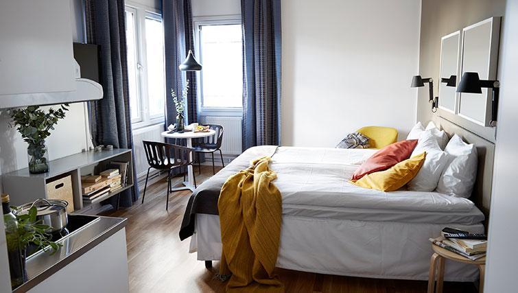 Bed at Forenom Aparthotel Stockholm Kista - Citybase Apartments