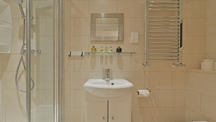 Bathroom at Great Titchfield Street Apartment - Citybase Apartments