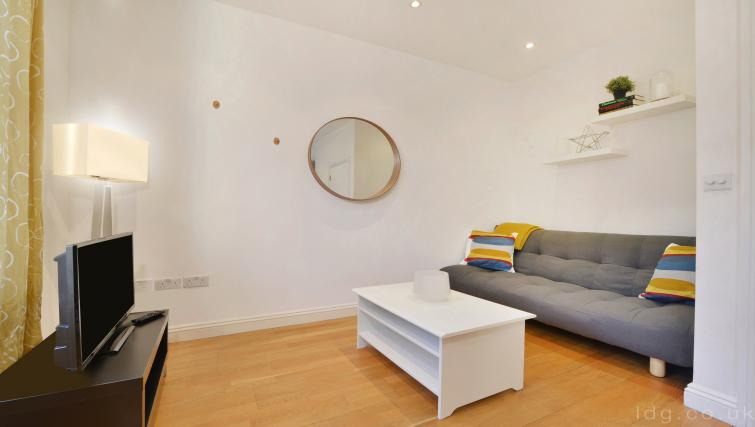 Sofa at Great Titchfield Street Apartment - Citybase Apartments