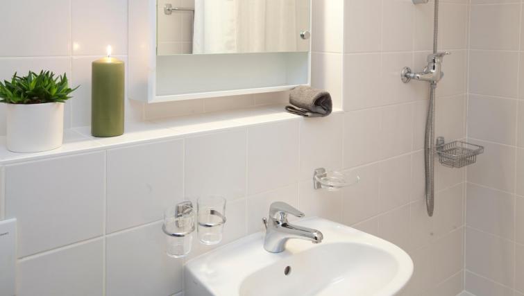 Bathroom at Goetz Monin Apartments - Citybase Apartments