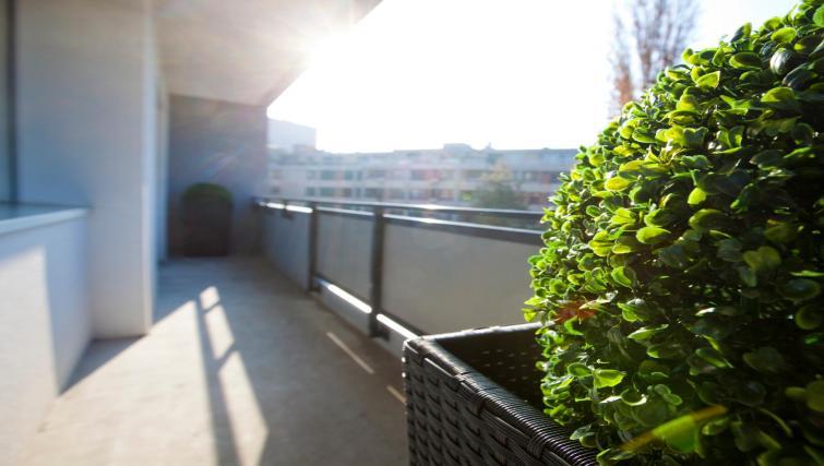 Balcony at Goetz Monin Apartments - Citybase Apartments