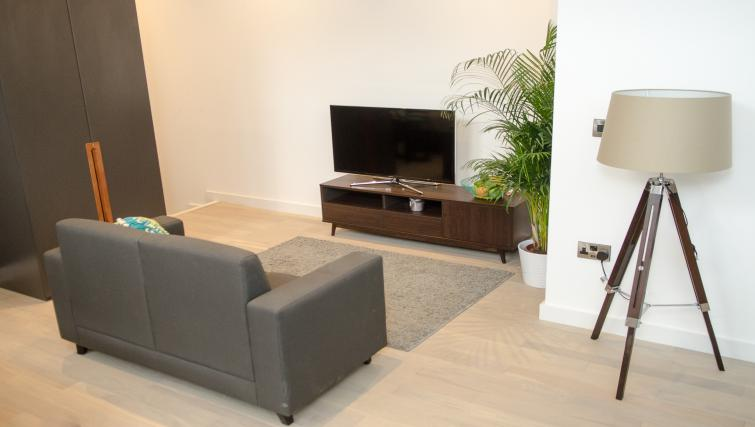 Living room at FM Living Apartments - Citybase Apartments