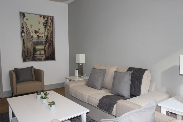 Living room at Le Mairie Apartments - Citybase Apartments