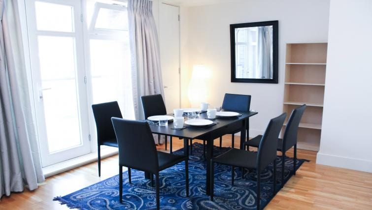Dining area at Flying Butler Westrovia Apartments - Citybase Apartments