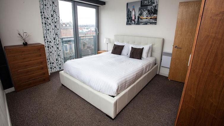 Bed at Cranbrook House Apartments - Citybase Apartments