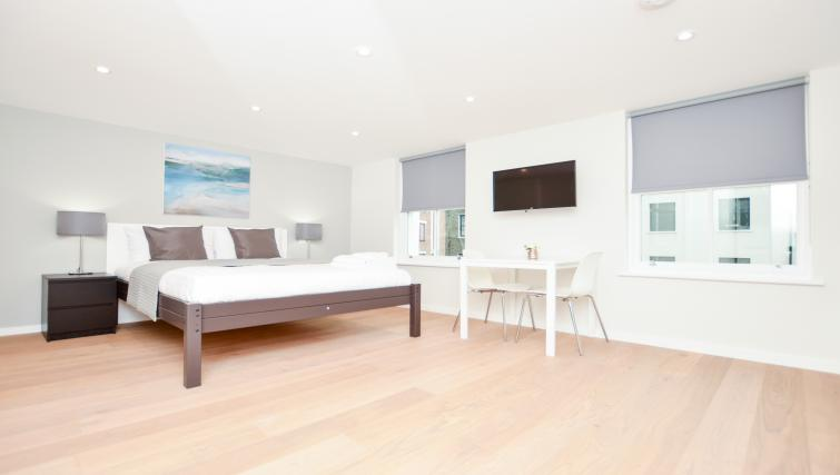 Large open-plan living area at Warren Street Serviced Apartment - Citybase Apartments
