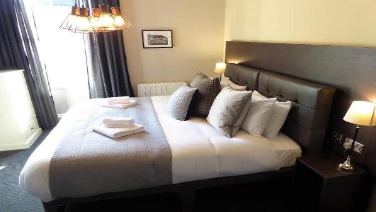 Double bed at Claremont Apartments - Citybase Apartments