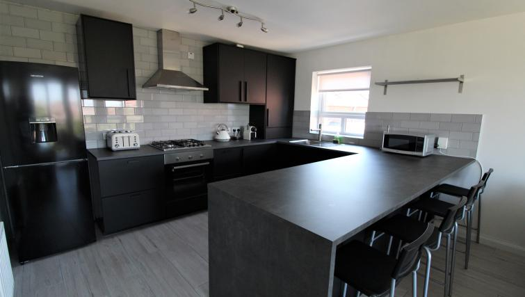 Black kitchen at the Belfast Penthouse & Apart - Citybase Apartments