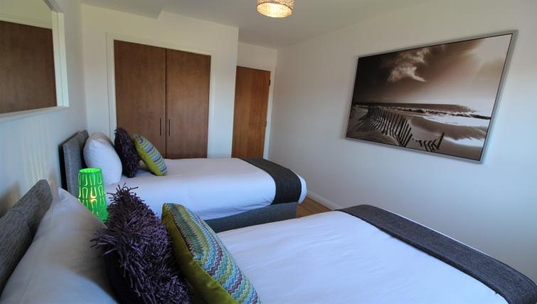 Twin beds at the Belfast Penthouse & Apartments - Citybase Apartments