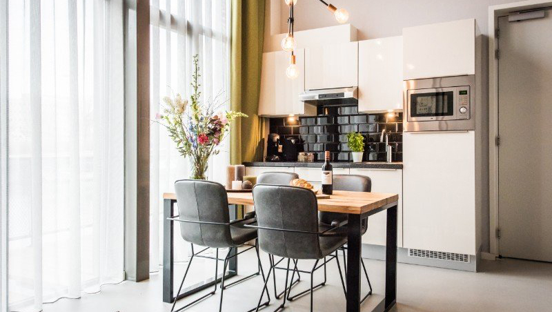 Dining table at Eastern Docklands Apartments, Amsterdam - Citybase Apartments