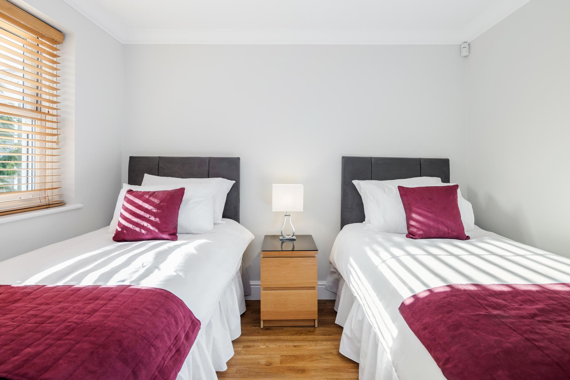 Twin beds at Little Orchard Place Apartments, Centre, Esher - Citybase Apartments