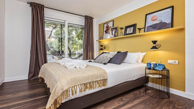 Bed at Plaza Espana Fira Apartment - Citybase Apartments