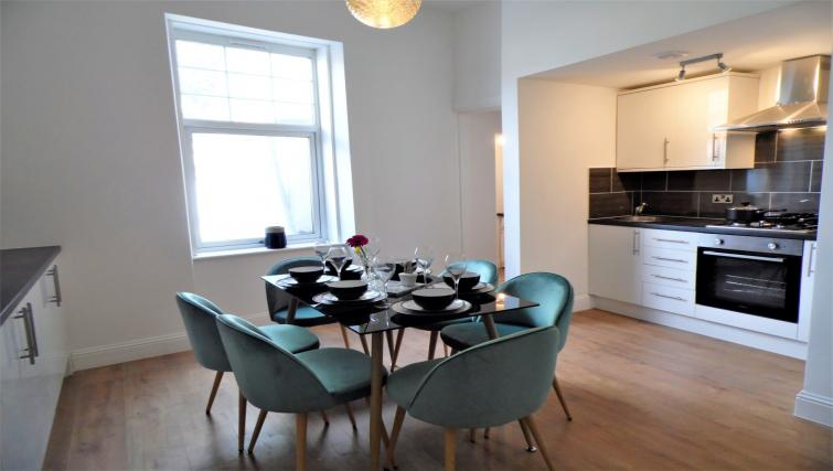 Dining table at Langlands House - Citybase Apartments